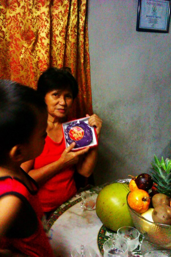"""This is my superstitious mom striking a pose with her """"Tikoy"""" a Chinese sticky delicacy."""